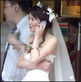 20080225-Chinabride on cell phone textuallyspeaking com.jpg