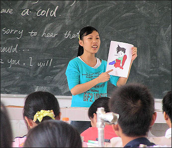 20111124-Wiki C schoolsStudent_teacher_in_China.jpg