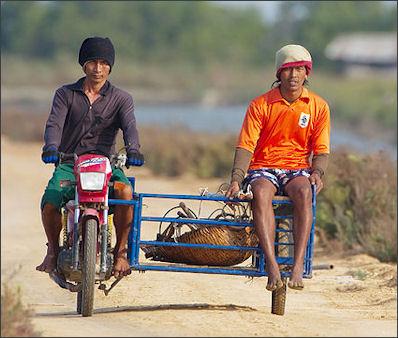 20120514-Salt_Farmers_on_motorbike_-_Pak_Thale.jpg