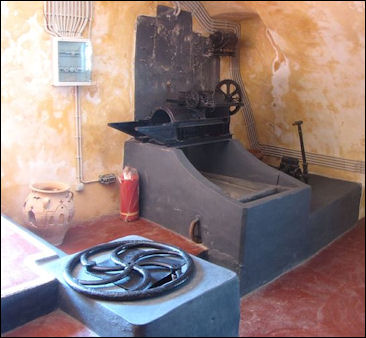 20120528-wine -Old_Fashioned_Wine_Making_equipment_in_Greece_.jpg
