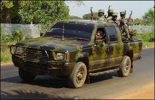 20120710-LTTE_car_with_soldiers_in_Killinochi_april_2004.jpg