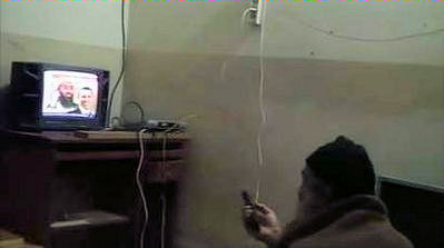20120712-Osama_bin_Laden_watching_TV_at_his_compound_in_Pakistan-3.jpg