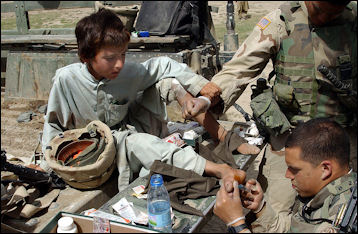 20120514-Young_Afghan_boy_recieving_medical_treatment_by_US_specialists.jpg